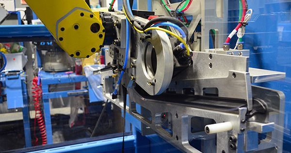 Industrial Robot applying tape and flock